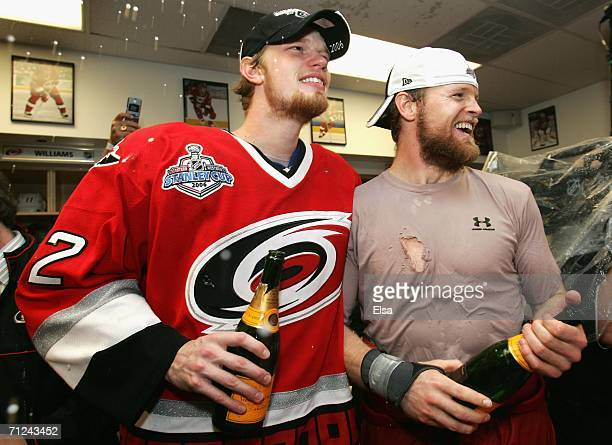 Eric Staal and Kevyn Adams of the Carolina Hurricanes celebrate in the lockerroom after defeating the Edmonton Oilers in game seven of the 2006 NHL...