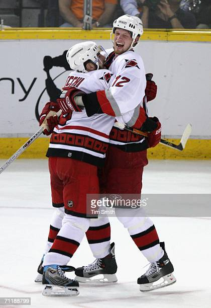 Eric Staal and Mark Recchi of the Carolina Hurricanes celebrate after Mark Recchi scored the go ahead goal against the Edmonton Oilers during the...