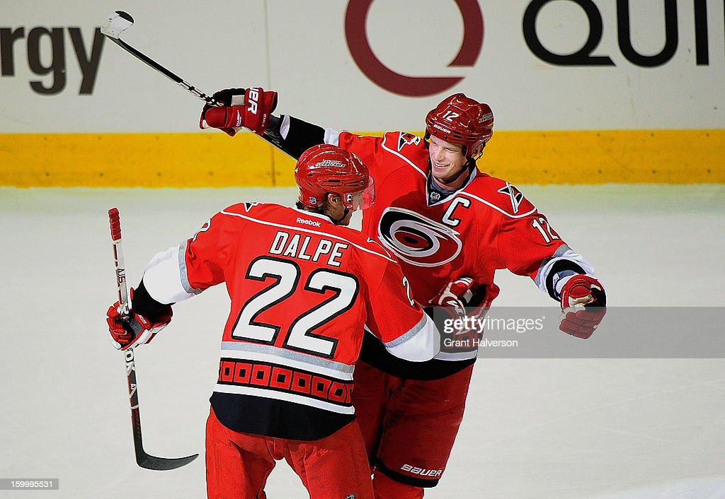 Eric Staal #12 and Zac Dalpe #22 of the Carolina Hurricanes celebrate Staal's third goal of the game during the third period against the Buffalo Sabres at PNC Arena on January 24, 2013 in Raleigh, North Carolina. Carolina defeated Buffalo, 6-3.