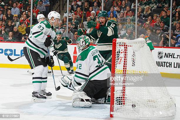 Eric Staal celebrates after his Minnesota Wild teammate Nino Niederreiter scores a goal with Esa Lindell and goalie Kari Lehtonen of the Dallas Stars...