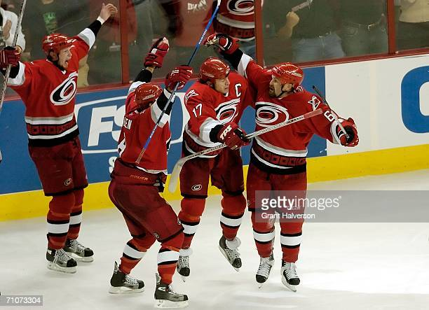 Eric Staal, Matt Cullen, Rod Brind'Amour and Cory Stillman of the Carolina Hurricanes celebrate winning the game 4-3 on a goal by Stillman in...