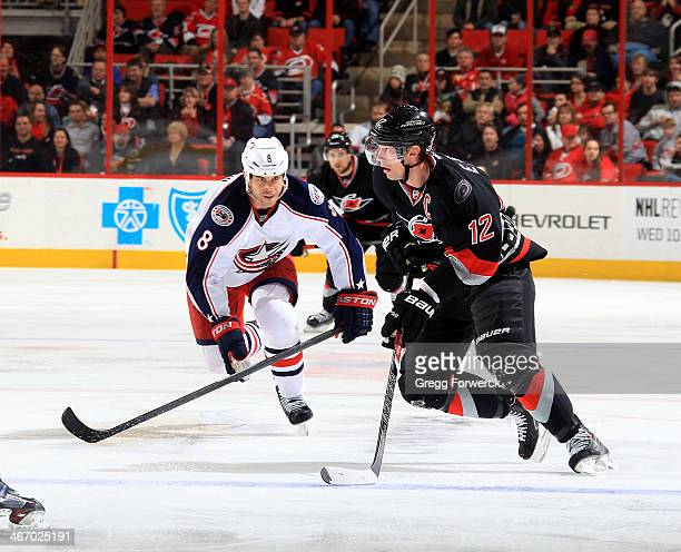 Eric Staal of the Carolina Hurricanes caries the puck into the zone during their NHL game against the Columbus Blue Jackets at PNC Arena on January...