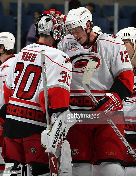 Eric Staal of the Carolina Hurricanes celebrates an overtime win with teammate Cam Ward against the New York Islanders on January 21 2008 at Nassau...