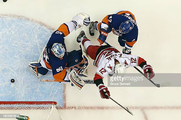 Eric Staal of the Carolina Hurricanes celebrates his second period goal against Kevin Poulin of the New York Islanders at the Nassau Veterans...