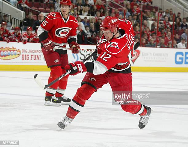 Eric Staal of the Carolina Hurricanes fires a slapshot and scores a powerplay goal during a NHL game against the New York Rangers on April 2 2009 at...