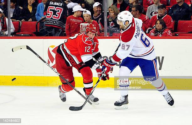 Eric Staal of the Carolina Hurricanes loses his stick as he battle for a loose puck with Max Pacioretty of the Montreal Canadiens during play at PNC...