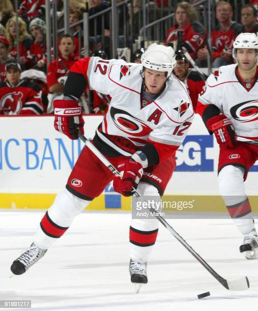 Eric Staal of the Carolina Hurricanes plays the puck against the New Jersey Devils during their game at the Prudential Center on October 17, 2009 in...