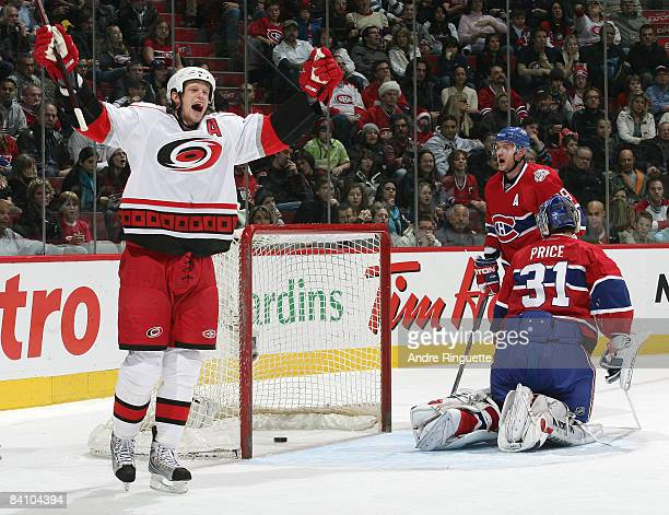 Eric Staal of the Carolina Hurricanes raises his arms to celebrate his second period power play goal against Andrei Markov and Carey Price the...
