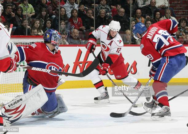 Eric Staal of the Carolina Hurricanes scores a power play goal against Carey Price and Andrei Markov of the Montreal Canadiens at the Bell Centre on...