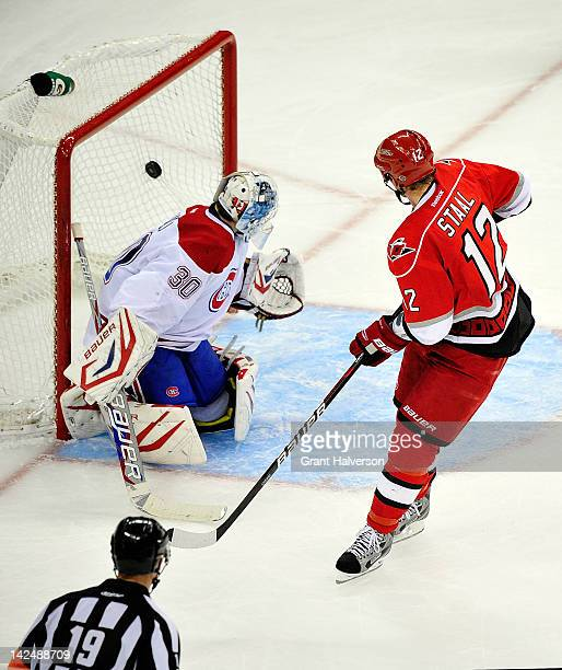 Eric Staal of the Carolina Hurricanes scores the game-winning goal against Peter Budaj of the Montreal Canadiens during a shootout at PNC Arena on...