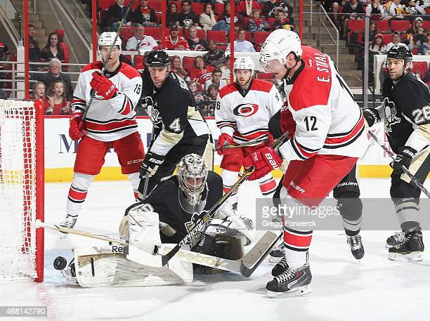 Eric Staal of the Carolina Hurricanes shoots the puck on net as MarcAndre Fleury of the Pittsburgh Penguins deflects the puck away during their NHL...