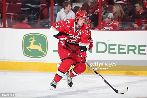 Eric Staal of the Carolina Hurricanes skates with the puck during a NHL game against the Boston Bruins on February17, 2009 at RBC Center in Raleigh,...