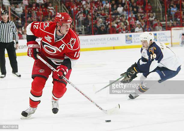 Eric Staal of the Carolina Hurricanes skates with the puck during their NHL game against the Atlanta Thrashers on March 28 2008 at RBC Center in...