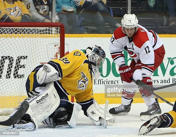 Eric Staal of the Carolina Hurricanes takes the shot on Marek Mazanec of the Nashville Predators during the first period at the Bridgestone Arena on...
