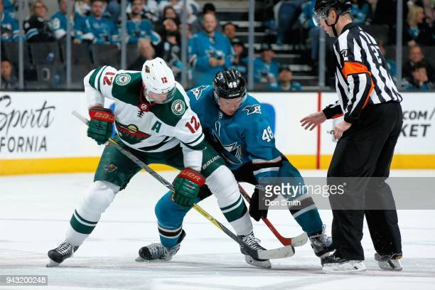 Eric Staal of the Minnesota Wild and Tomas Hertl of the San Jose Sharks faceoff at SAP Center on April 7 2018 in San Jose California