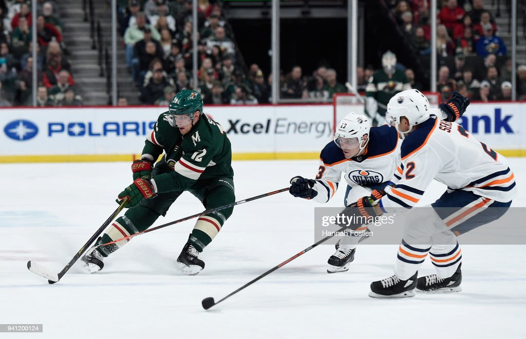 Eric Staal #12 of the Minnesota Wild controls the puck against Michael Cammalleri #13 and Andrej Sekera #2 of the Edmonton Oilers during the first period of the game on April 2, 2018 at Xcel Energy Center in St Paul, Minnesota. The Wild defeated the Oilers 3-0.