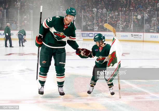 Eric Staal of the Minnesota Wild shakes hands with the honorary flag bearer before a game between the Minnesota Wild and Las Vegas Golden Knights at...