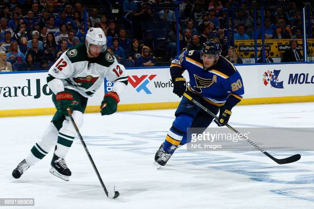 Eric Staal of the Minnesota Wild skates with the puck as Alexander Steen of the St Louis Blues pressures in Game Three of the Western Conference...