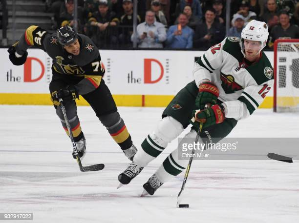 Eric Staal of the Minnesota Wild skates with the puck as Ryan Reaves of the Vegas Golden Knights gives chase in the first period of their game at...