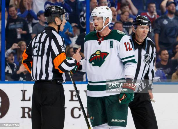 Eric Staal of the Minnesota Wild talks to referee TJ Luxmore during the game against the Tampa Bay Lightning at Amalie Arena on December 23 2017 in...