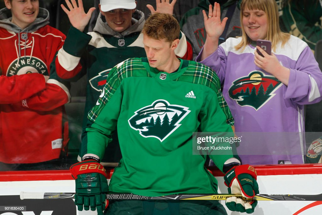 Eric Staal #12 of the Minnesota Wild wears a green St. Patrick's Day jersey during warmups prior to the game against the Colorado Avalanche at the Xcel Energy Center on March 13, 2018 in St. Paul, Minnesota.
