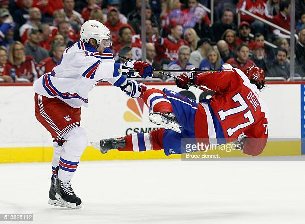 Eric Staal of the New York Rangers checks TJ Oshie of the Washington Capitals during the second period at the Verizon Center on March 4 2016 in...