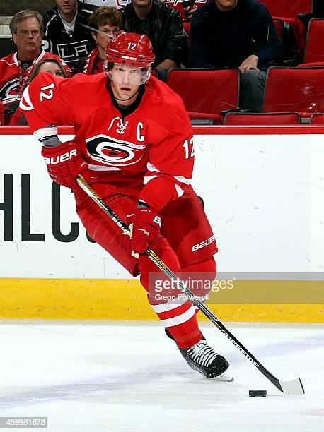 Eric Staal#12 of the Carolina Hurricanes caries the puck during an NHL gae against the Washington Capitals at PNC Arena on December 4 2014 in Raleigh...