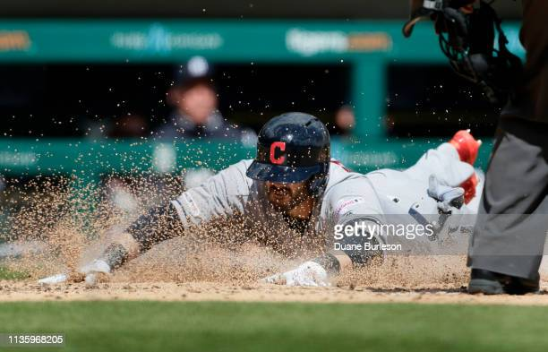 Eric Stamets of the Cleveland Indians scores on his hit to center field that was defelected by center fielder Mikie Mahtook of the Detroit Tigers...