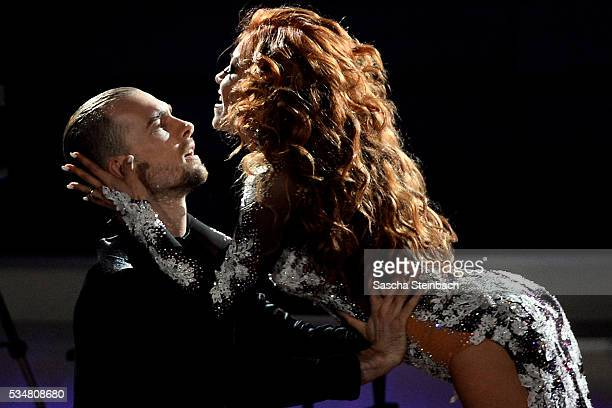 Eric Stehfest and Oana Nechiti perform on stage during the 11th show of the television competition 'Let's Dance' at Coloneum on May 27 2016 in...