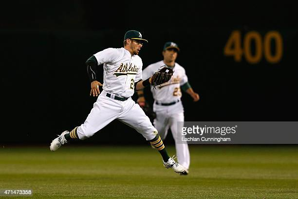Eric Stogard of the Oakland Athletics catches a fly ball hit by CJ Cron of the Los Angeles Angels of Anaheim in the seventh inning at Oco Coliseum on...