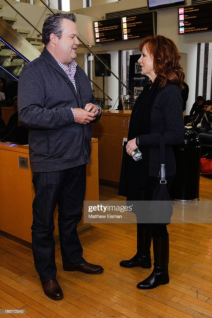 Eric Stonestreet (L) and Reba McEntire visit SiriusXM Studios on February 5, 2013 in New York City.
