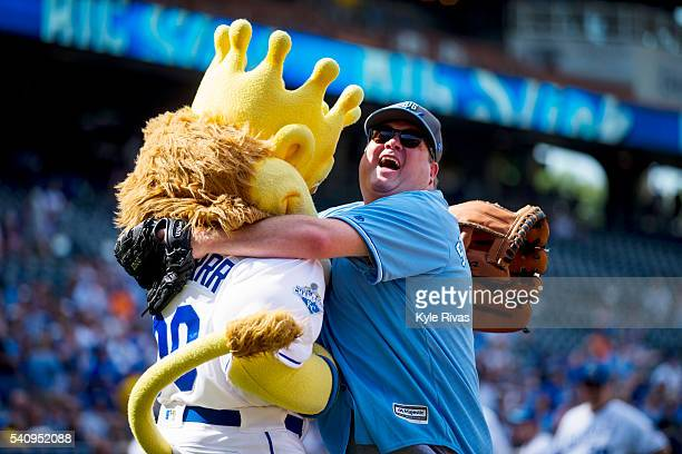 Eric Stonestreet embraces Kansas City Royals mascot Sluggerrr during the Big Slick Celebrity Softball Game benefitting Children's Mercy Hospital of...
