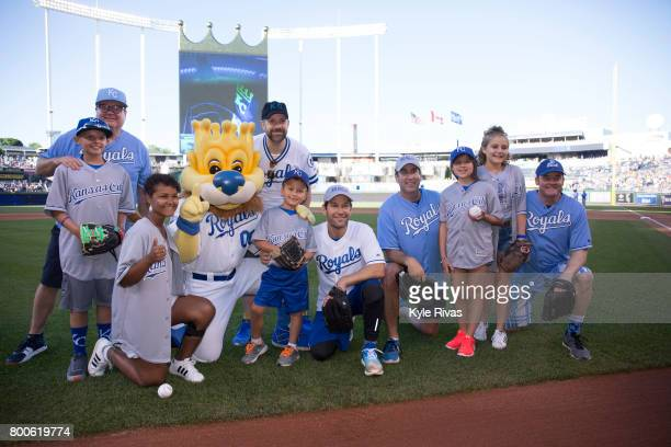 Eric Stonestreet Jason Sudeikis Paul Rudd Rob Riggle and David Koechner pose for a photo after the first pitch during the Big Slick Celebrity Weekend...