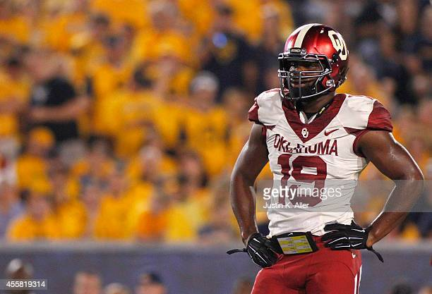 Eric Striker of the Oklahoma Sooners looks on in the first half against the West Virginia Mountaineers during the game on September 20 2014 at...