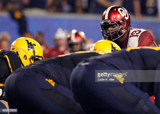 Eric Striker of the Oklahoma Sooners looks on in the second half against the West Virginia Mountaineers during the game on September 20 2014 at...