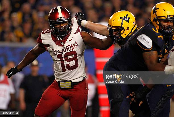 Eric Striker of the Oklahoma Sooners plays against the West Virginia Mountaineers during the game on September 20 2014 at Mountaineer Field in...