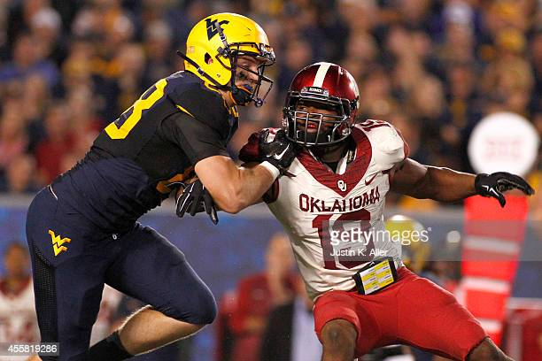 Eric Striker of the Oklahoma Sooners rushes the passer in the first half against the West Virginia Mountaineers during the game on September 20 2014...