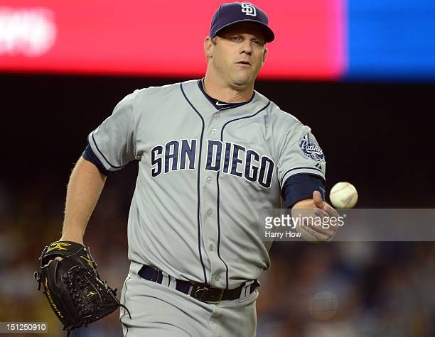 Eric Stults of the San Diego Padres makes a play to first base for an out of Andre Ethier of the Los Angeles Dodgers during the fourth inning at...