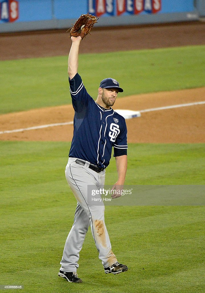 Eric Stults #53 of the San Diego Padres reacts to a ground rule double by Adrian Gonzalez #23 of the Los Angeles Dodgers during the third inning at Dodger Stadium on August 20, 2014 in Los Angeles, California.