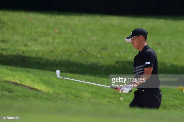 Eric Sugimoto of Japan prepares to play his shot out of the bunker on the first hole of Round 3 on day 3 of the Singapore Open at Sentosa Golf Club...