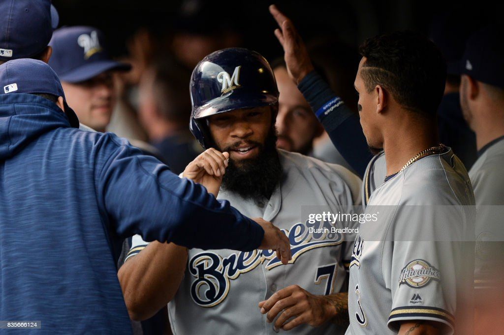 Eric Thames #7 of the Milwaukee Brewers celebrates a run scored in the third inning of a game against the Colorado Rockies at Coors Field on August 19, 2017 in Denver, Colorado.