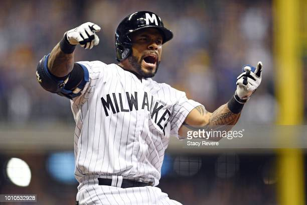 Eric Thames of the Milwaukee Brewers celebrates a three run walk off home run against the Colorado Rockies during the ninth inning of a game at...