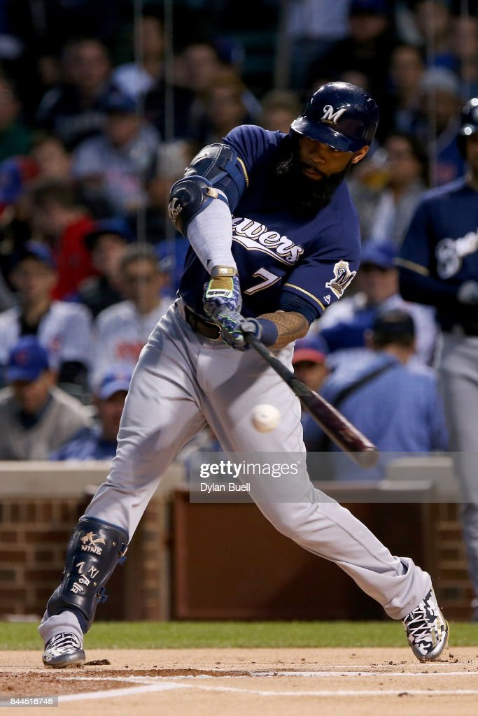Eric Thames #7 of the Milwaukee Brewers hits a double in the first inning against the Chicago Cubs at Wrigley Field on September 8, 2017 in Chicago, Illinois.