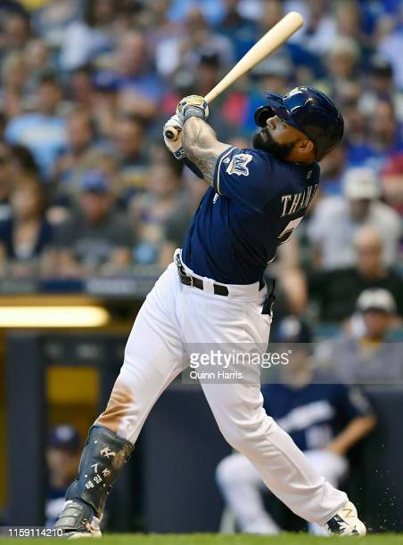 Eric Thames of the Milwaukee Brewers watches his solo home run leave the park in the fourth inning against the Pittsburgh Pirates at Miller Park on...