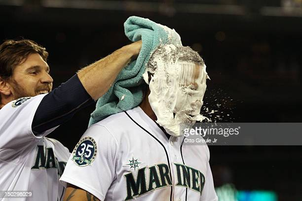 Eric Thames of the Seattle Mariners gets a shaving cream pie from John Jaso after getting the game winning hit in the bottom of the ninth inning to...