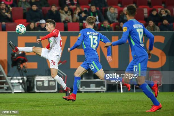 Eric Thommy of Augsburg controls the ball during the Bundesliga match between FC Augsburg and VfL Wolfsburg at WWKArena on November 25 2017 in...