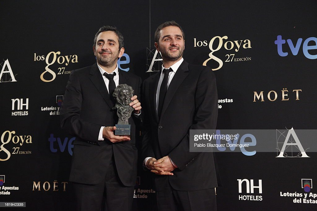 Eric Toledano and Olivier Nakache holds his award for Best European Film in the film 'Intocable' during the 2013 edition of the 'Goya Cinema Awards' ceremony at Centro de Congresos Principe Felipe on February 17, 2013 in Madrid, Spain.