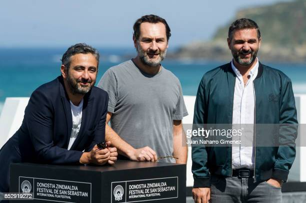 Eric Toledano Olivier Nakache and Gilles Lellouche attends 'Le Sens De La Fete / C'Est La Vie' photocall during 65th San Sebastian Film Festival on...