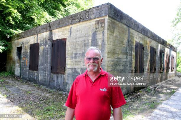 """Eric Trinon, member of the """"Association de Sauvegarde du Wolfsschlucht II"""" , poses in front of the Adolf Hitler's bunker at the """"Wolfsschlucht II"""", a..."""