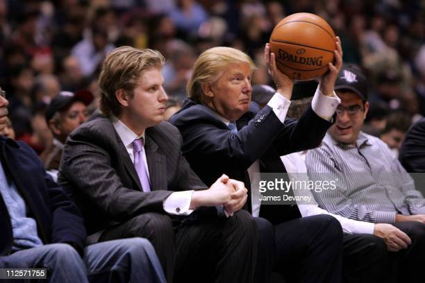 Eric Trump and Donald Trump attend the Chicago Bulls vs New Jersey Nets game at the IZOD Center on October 31 2007 in East Rutherford New York